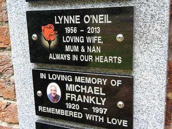 Garden Wall Plaques in black granite with inscription and illustration